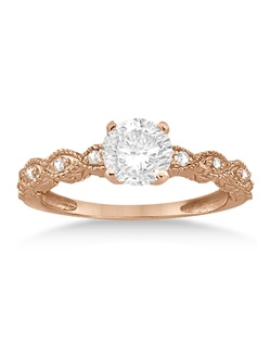 Crafted in 14kt Rose Gold (pink gold), 16 diamonds adorn this diamond engagement ring with matching wedding band bridal set. The diamonds are of near-colorless G-H Color, VS1 Clarity and are set in a pave setting.  The heirloom ring features hand set diamonds that sit within marquise shapes on a band that has milgrained edges and scroll work.  Design your own engagement ring with an oval, princess, round, cushion cut, or other shape center stone of your choice that fits into the prong mounting.  This vintage inspired bridal set is also available in other metals and stones.