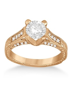 This stunning vintage style 14 karat rose gold engagement ring setting with side stone accents features thirty-eight brilliant-cut round diamonds (approximate) of G-H Color, VS2-SI1 Clarity. Unique scrollwork, milgrain edges, and a flared band complete this stylish ring.