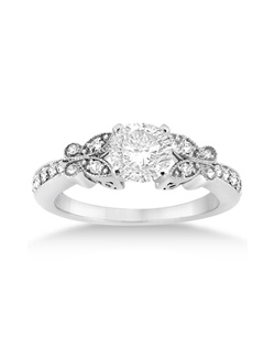 This unique butterfly shaped side stone accented engagement ring showcases a total of 14 round cut diamonds that are beautifully set in a 14kt White Gold band. The bright and near-colorless diamonds are of G-H Color, VS1 Clarity. This fancy designer engagement ring setting is completed with milgrain edges and a polished finish.