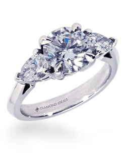 1.75ct round center stone with 0.6CTW pearshaped diamond side stones set in platinum.