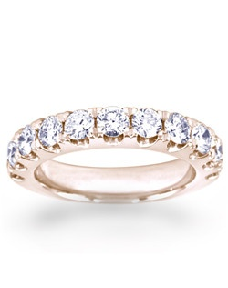 11 Stone wedding band with 1.1CTW of diamonds set in 14Krose gold.
