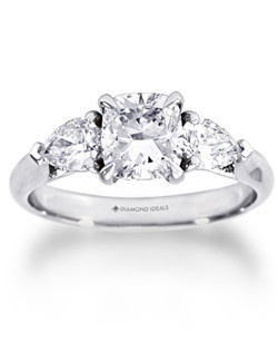 1.5 carat Cushion shaped diamond surrounded by 2 pear shapes 0.80CTW set in 18K white gold.