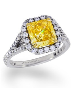 This platinum and Yellow gold Split-shank Halo engagement ring features a 2 carat fancy vivid yellow radiant-cut diamond surrounded by 0.6CTW of mêlée diamonds.