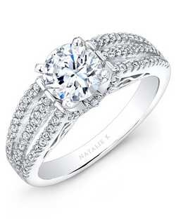 Brilliant round white diamonds cover the three row split shank in the magnificant diamond engagement ring of this 14k white gold bridal set. The beautiful wedding band features even more pave set round white diamonds. Total carat weight: 0.58cts. Center stone not included. Can be made to fit any size or shape center stone.  Available in 14k, 18k and platinum.