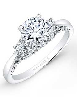 Two brilliant round white diamonds sit on either side of a center mounting that sits on top of a dazzling gallery covered in diamonds in this beautiful diamond engagement ring. Total carat weight: 0.36cts. Center stone not included. Can be made to fit any size or shape center stone.   Available in 14k, 18k and platinum.
