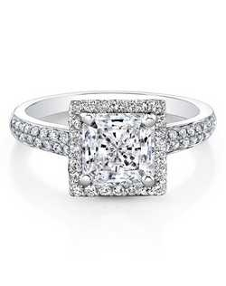 A square halo sits above a shank covered in two rows of pave-set diamonds on this stunning 18k white gold engagement ring. Total carat weight: 0.43cts. Center stone not included. Can be made to fit any size or shape center stone.      