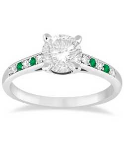 This unique side stone accented diamond and emerald engagement ring for women displays 4 emeralds and 6 diamonds, each round-cut and pave-set in an elegant cathedral style band.