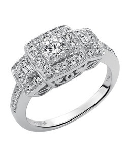 Ladies 14kt White Gold  3/4 ctw Engagement Ring.  Prong Set with a Round Cut Center, and Round and Baugette Side stones.