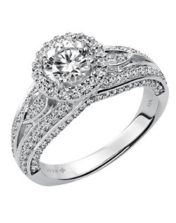 Ladies 14kt White Gold  1 1/2  ctw Engagement Ring.  Prong Set with a Round Cut Center, and Round Side stones.