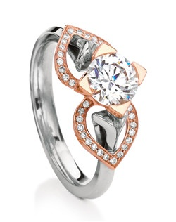 Our iconic Eriskay engagement ring takes on a fresh new look with beautiful heart-shaped pave diamond 'wings' that hug the finger and frame the center stone.