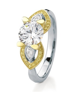 Our iconic Eriskay engagement ring with beautiful heart-shaped 'wings' framing delicate flush-set pear-shape diamonds