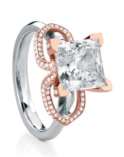 Statement engagement ring named after the Scottish island of Lismore, featuring beautiful flowing wings surrounding the center stone inset with micro-pave diamonds on every side