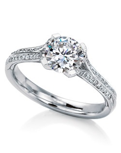 Round brilliant-cut solitaire named after the Scottish island of Oronsay. Perfectly balanced classic design, with a sleek setting and tailored pave diamond shank that elegantly showcases the gemstone