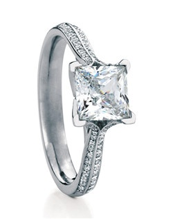 Princess-cut solitaire named after the Scottish island of Westray. Elegant four-prong setting with flowing side profile and neatly tailored shank, set with 2 rows of delicate pave diamonds