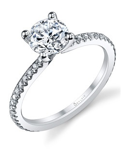 This classic diamond engagement ring features a 1 carat round brilliant center accentuated with 0.21 total weight diamonds.