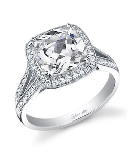 This stunning 18K white gold diamond engagement ring features a 1.50 carat radiant-cut center diamond. Beautifully designed to accentuate the center diamond, this diamond engagement ring has a total of 0.44 carats of diamonds flowing down the split shank.