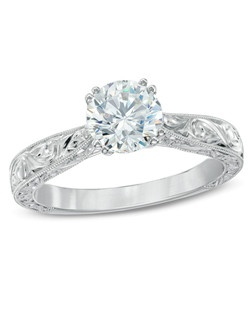 On the day you ask for her hand in a marriage commitment, honor her with this exceptional vintage-inspired diamond solitaire engagement ring. Fashioned in 14K white gold, the eye is drawn to the 1 ct. Celebration Fire® diamond at the heart of this design. Boasting a color ranking of H - I and clarity of SI1 - SI2, master craftsmen cut 71 precise facets that create a pattern of ten hearts and ten arrows on every Celebration Fire® diamond. This diamond tops an intricately sculpted, milgrain-edged shank. This ring arrives with a certificate that includes a photo and a description of the diamond. The certificate guarantees quality and can be used for insurance purposes.