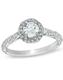 For the unforgettable moments in your life, celebrate with an expression of your love: a 7/8 ct. t.w. Celebration 102® diamond engagement ring. Fashioned in 18K white gold, this stunning engagement ring showcases a 1/2 ct. round Celebration 102® diamond center stone framed with an array of smaller round accent diamonds, which also adorn the ring's cascading shank. Every Celebration 102® diamond received excellent rankings for superior cut and color. Insuring authenticity and protection, each diamond is laser-inscribed with a certification number inside of the band. This ring comes with a certificate that includes a photo and a description of the diamond, which guarantees quality and can be used for insurance purposes.