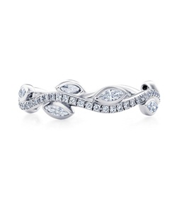 Inspired by Aphrodite's love for her Adonis, this unique band is carefully crafted in platinum and bezel set with marquise diamonds and pavé round brilliant diamonds. Total carat weight for a standard size is approximately 0.56. Size range from 46 to 57.
