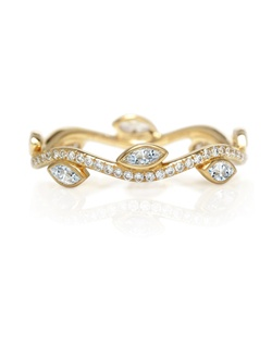 Inspired by Aphrodite's love for her Adonis, this unique band is carefully crafted in yellow gold and bezel set with marquise diamonds and pavé round brilliant diamonds. Total carat weight for a standard size is approximately 0.56. Size range from 46 to 57.