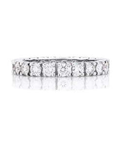 This timelessly elegant 2.5 mm (0.10 in.) wide platinum band is beautifully prong set with round brilliant diamonds. Total carat weight for a standard size is approximately 1.36. Colour grade G+, clarity grade VS+.