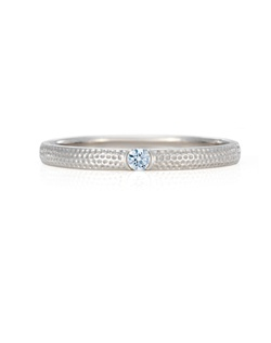 Sublimely sophisticated, graceful and elegant, this white gold 2mm band is simple and precious with one specially selected diamond in its centre. Total carat weight 0.03.