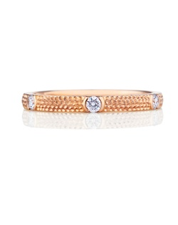Playful and timelessly romantic, one single diamond is set intricately in a pink gold 2mm band. Total carat weight 0.03.
