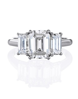 A classic and elegant trio of carefully selected four prong-set emerald-cut diamonds crafted on a platinum band. A wide selection of colour and clarity grades is available in our stores. Total carat weight of the diamond rings depends on centre and side diamonds.