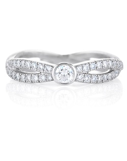 The infinity design represents a path of never-ending possibilities. Two eternal, interweaving paths of pavé diamonds around the white gold band symbolise the everlasting beauty of diamonds themselves with a central solitaire to capture the sparkle of a precious moment. Band carat weight is 0.79cts with a 0.10ct solitaire.