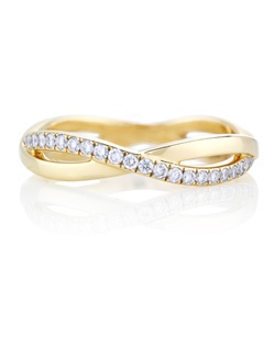 The infinity design represents a path of never-ending possibilities. An eternal, interweaving path of pave diamonds around the yellow gold band symbolise the everlasting beauty of diamonds themselves. Total carat weight is 0.36cts.