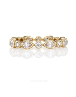 Symbolic of the rejuvenation of spring, delicate diamond petals flourish in a yellow gold band intricately set with sixteen specially selected pear-cut and round brilliant diamonds. Total carat weight 0.70. Colour grade G+, clarity grade VS+. Bezel setting. Band is 3 mm (0.12 in.) in width.