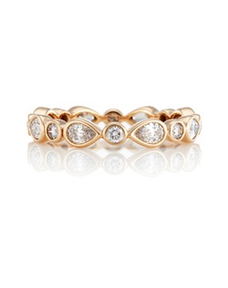 Symbolic of the rejuvenation of spring, delicate diamond petals flourish in a pink gold band intricately set with sixteen specially selected pear-cut and round brilliant diamonds. Total carat weight 0.70. Colour grade G+, clarity grade VS+. Bezel setting. Band is 3 mm (0.12 in.) in width.