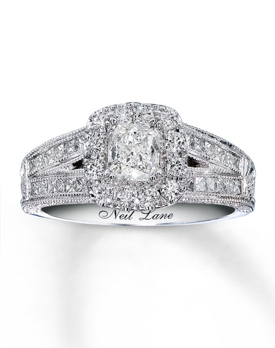 Neil Lane has succeeded in blending vintage Hollywood style with a brilliance that transcends time. A spectacular cushion-cut diamond is the sparkling centerpiece of this extraordinary engagement ring for her. Round diamonds brilliantly frame the center as princess-cut diamonds decorate the 14K white gold band and matching wedding band for added sparkle. Each Neil Lane Bridal® diamond ring is hand-crafted and undergoes a four-step polishing process, which gives the ring its beautiful shine and luster. The diamond bridal set has a total diamond weight of 1 5/8 carats and features Neil Lane's signature on the inside of both bands. Diamond Total Carat Weight may range from 1.58 - 1.68 carats.