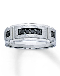 This impressive men's band features Artistry Black Diamonds™. This unique and masculine ring is set in 10K white gold, and has a total diamond weight of 1/4 carat. Artistry Black Diamonds™ are treated to permanently create the intense black color. Diamond Total Carat Weight may range from .23 - .28 carats.