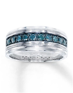 Round Artistry Blue Diamonds™ flow across a band of sterling silver in this attractive ring for him. The ring has a total diamond weight of 1/2 carat. Artistry Blue Diamonds™ are treated to permanently create the intense blue color. Diamond Total Carat Weight may range from .45 - .57 carats.