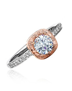 If your woman is not too complicated or fancy then this ones perfect for her.  The Sage ring featured has a round center sitting inside a satin cushion top with pave diamonds on white gold shank.  Two pink gold polish bands envelopes the featured ring.  Available in any size center and metal.  (center not included)