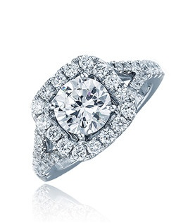 Diamonds line up the white gold tappered split shank which holds the round center stone that sits on a cushion halo top surrounded by diamonds on white gold. This ring is made for your special lady.  Available in any size center and metal.  (center not included).  16 DIA 0.33 CT