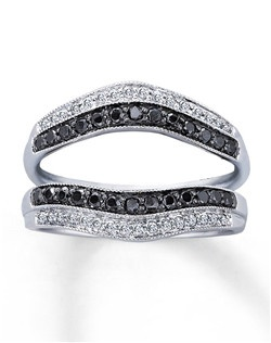Contrasting rows of white diamonds and Artistry Black Diamonds™ grace either side of your diamond solitaire in this dynamic enhancer ring. The 14K white gold setting features milgrain edging. This lovely enhancer ring has a total diamond weight of 1/2 carat. The diamond solitaire is sold separately. Artistry Black Diamonds™ are treated to permanently create the intense black color. This fine jewelry enhancer ring is available at select stores. Available at select Kay Jewelers locations -- call 1-800-527-8029 for the store nearest you. Diamond Total Carat Weight may range from .45 - .57 carats.