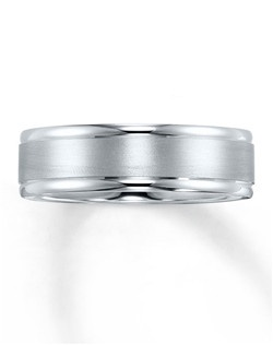 This handsome wedding band for him is crafted in 10K white gold and features a combination of brushed and high-polish finishes.