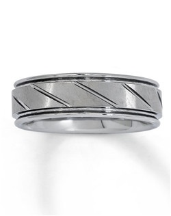 This handsome 7mm men's wedding band is crafted of tungsten carbide, which is made from a patented formula and is prized for its strength and durability.