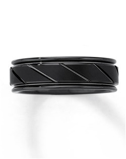 Black coating and diagonal carved details lend contemporary style to this handsome 7mm men's wedding band. The tungsten carbide composition of this fine jewelry ring is made from a patented formula and is prized for its strength and durability. The Supreme-Fit™ band offers maximum comfort.