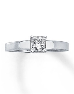 A 1/2 carat princess-cut, prong-set diamond is the main attraction of this striking solitaire ring, set in beautiful 14K white gold. Diamond Total Carat Weight may range from .45 - .57 carats.
