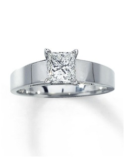 A 1 carat princess-cut diamond is brilliantly displayed in a band of 14K white gold. Artisans have cut and polished this diamond to achieve a near-colorless look that captures light beautifully. This lovely engagement ring is secured in a prong setting. Diamond Total Carat Weight may range from .95 - 1.11 carats.
