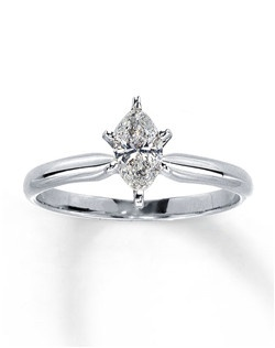 This stunning marquise diamond solitaire is secured by six prongs in a 14K white gold setting, with a diamond weight of 1/2 carat. Diamond Total Carat Weight may range from .45 - .57 carats