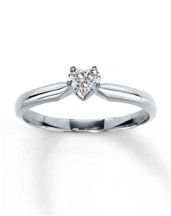A divine heart-shaped diamond solitaire provides romantic sparkle in this 14K white gold engagement ring for her, with a diamond weight of 1/4 carat. Diamond Total Carat Weight may range from .23 - .28 carats.