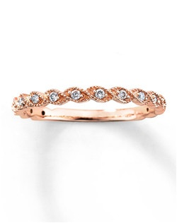 Round sparkling diamonds are set in twists of 14K rose gold in this lovely diamond ring band for her. The ring has a total diamond weight of 1/10 carat. Diamond Total Carat Weight may range from .085 - .11 carats