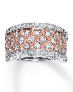 Diamond shapes in 14K rose gold frame sparkling round diamonds in this eye-catching ring for her. Additional diamonds set in 14K white gold line the top and bottom of the band to complete the look. The ring has a total diamond weight of 1 1/2 carats. Diamond Total Carat Weight may range from 1.45 - 1.57 carats.