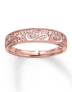 Brilliant round diamonds sparkle within a beautiful scroll and swirl design in this romantic diamond ring for her. The ring, crafted in 10K rose gold, features delicate milgrain detail and a total diamond weight of 1/20 carat. Diamond Total Carat Weight may range from .04 - .06 carats.