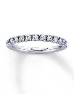 A row of beautifully matched round diamonds is featured in this fine jewelry anniversary band for her. A 14K white gold band complements the stunning diamonds, with a total diamond weight of 1/2 carat. Diamond Total Carat Weight may range from .45 - .57 carats.