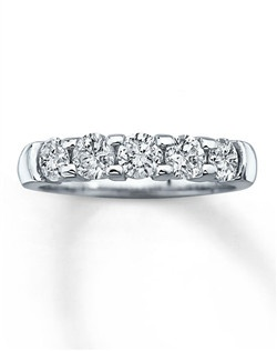 "This romantic diamond anniversary band features five sparkling round diamonds with a total diamond weight of one carat, set in 14K white gold. Say ""I love you now and always"" with this fine jewelry anniversary ring. Diamond Total Carat Weight may range from .95 - 1.11 carats."
